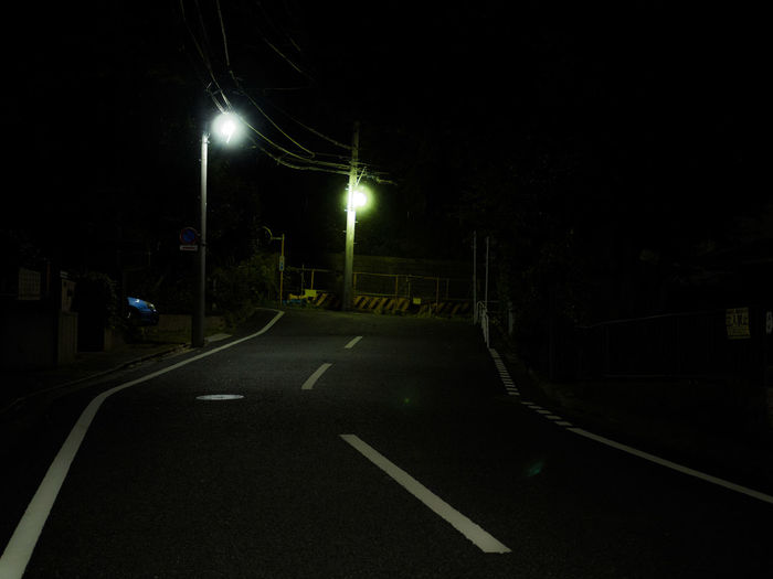 Surface level of street lights on road at night