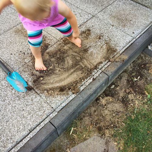 High Angle View Low Section Childhood Standing Child Lifestyles Casual Clothing Holding Person Innocence Day Elevated View Outdoors Unknown Gender Baby Clothing Playing In Dirt Dirty Dirt