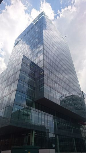 Skyscraper Modern Architecture Building Exterior Low Angle View Business Finance And Industry Cloud - Sky Façade City Sky No People Built Structure Outdoors Day Cityscape Sony Z5 Premium Sony Xperia Photography. Sony Xperia Clouds And Sky Manchester Spinningfields Reflection Style