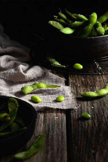 Edamame   food photography Food Wood - Material Food And Drink Healthy Eating Vegetable Green Color No People Close-up Still Life Raw Food Edamame Beans Dark Mood Food Photography Foodphotography Nikonphotographer Selective Focus Freshness
