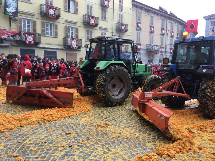 Carnival Crowds And Details Land Vehicle Building Exterior Machinery Outdoors Tractor Carnivale Di Ivrea Battle Of The Oranges Oranges Carnival Party