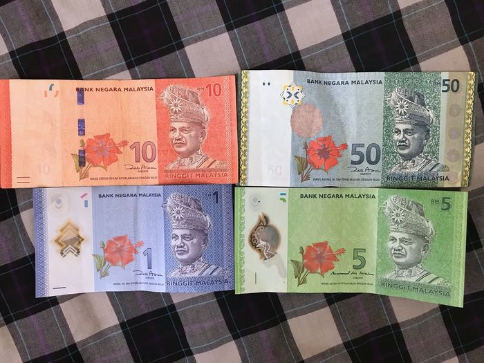 Four piece of different amount banknotes on a checkered background Checkered Pattern Beautiful Amount Money No People Multi Colored Indoors  Close-up Day