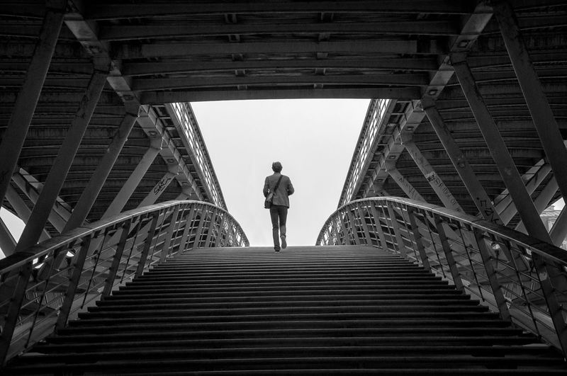 l'autre rive Alone Bridge Built Structure Geometry Man Metal Metallic Showcase: January Stairs Street Streetphoto_bw Streetphotography Symmetry The Week Of Eyeem