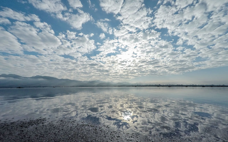 Inle Lake Reflection. Beauty In Nature Blue Calm Calmness Cloud - Sky Day Flat Inle Lake Lake Landscape Morning Myanmar Nature No People Outdoors Peace And Quiet Reflection Scenics Sky Still Tranquil Scene Water