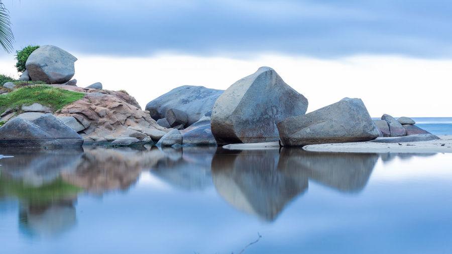 Reflection Tranquility Rock Solid Tranquil Scene Rock - Object Cloud - Sky Rock Formation Water Sea Sky Landscape