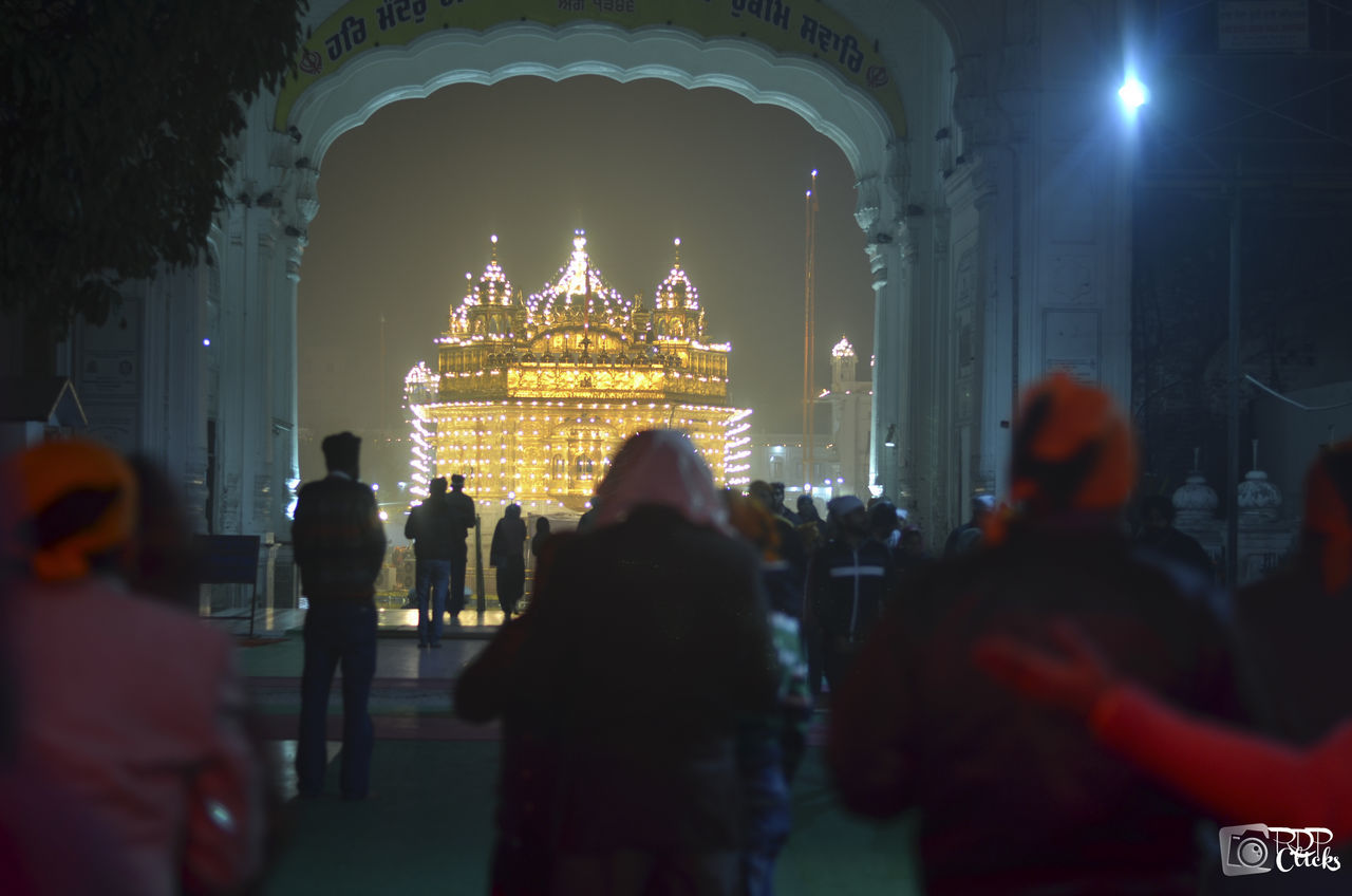 religion, place of worship, built structure, spirituality, architecture, illuminated, real people, travel destinations, building exterior, tourism, indoors, men, gold colored, lifestyles, night, women, sky