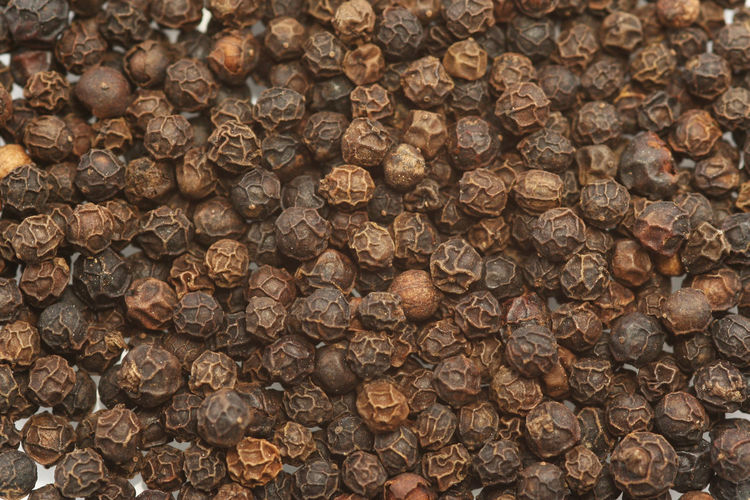Full frame shot of black peppercorns