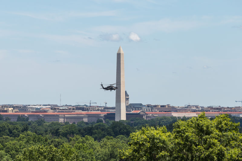 A military helicopter - Blackhawk - flies over the Washington, D.C. area and the Washington Monument City Helicopter Military Monument No People Outdoors Sky Urban Skyline Washington Monument Washington, D.C.