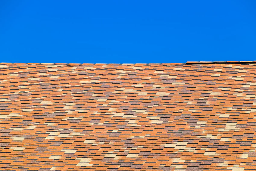 metal profile corrugated roof Architecture Blue Brick Wall Building Exterior Built Structure Clear Sky Day Low Angle View Metal Profile Corrugated Roof No People Outdoors Roof Sky Tiled Roof