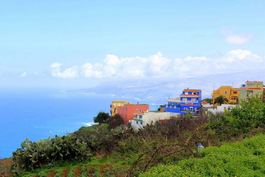 Colored Houses Architecture Beauty In Nature Blue Sky And Clouds Built Structure Cloud - Sky Landscape Nature Scenics Sea Sky Tenerife Teneriffa Tranquil Scene Tranquility Village On The Sea