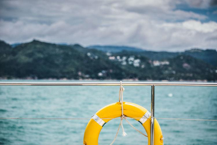 Life belt on boat railing at sea