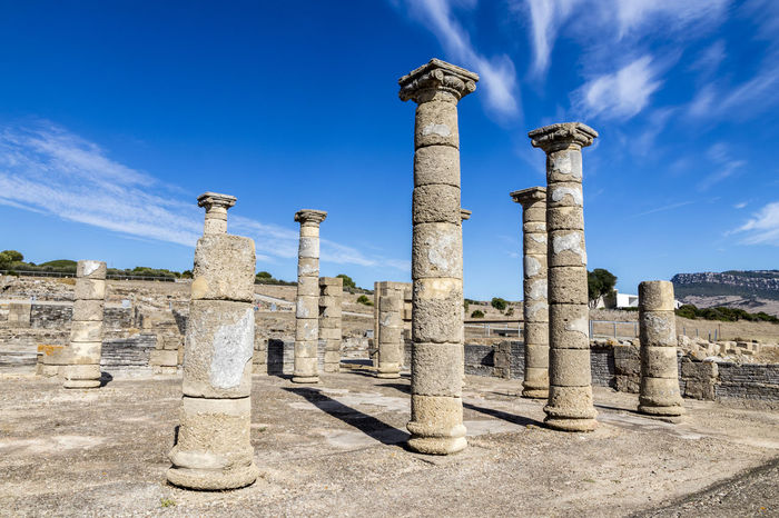 Ruins of Baelo Claudia, an ancient Roman town outside of Tarifa, near the village of Bolonia, in Andalusia, southern Spain Baelo Claudia Bolonia Spain Roman Ruins Abandoned Ancient Ancient Civilization Archaeology Architectural Column Architecture Blue Built Structure Cloud - Sky Damaged Day History No People Old Ruin Outdoors Sky Sunlight The Past Travel Destinations