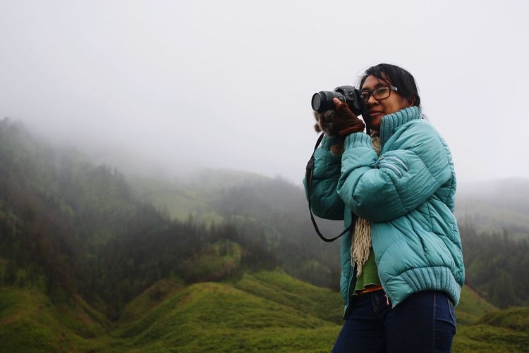 Woman photographing on camera