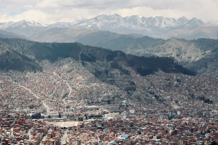 High angle shot of townscape against mountain range