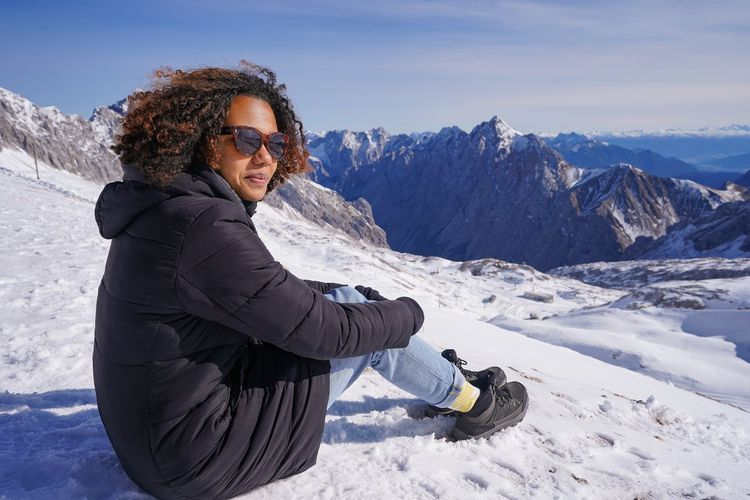 Woman standing on snow covered mountain