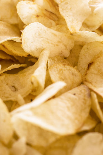 Appetizer Background Calories Chip Chips Close Closeup Concept Crisps Crispy Crunchy Delicious Diet Eat Eating Event Fast Fat Food Fried Gold Golden Holiday Junk Nobody Party Pattern Photo Potato Prepared Salt Salted Salty Snack Sweet Tasty Texture Thin Unhealthy Up Vertical Wallpaper Yellow