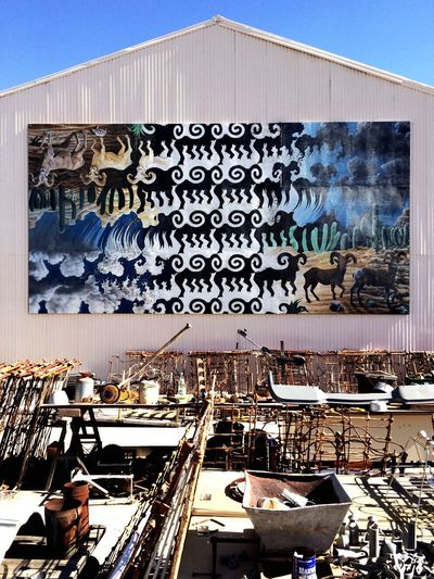 """""""Rams""""—a back-of-the-building tesselation (by artist Hop David)—presiding over recycled materials, Ajo, Arizona... Urban 4 Filter Arizona Street Art Ajo TakeoverContrast Art Is Everywhere"""