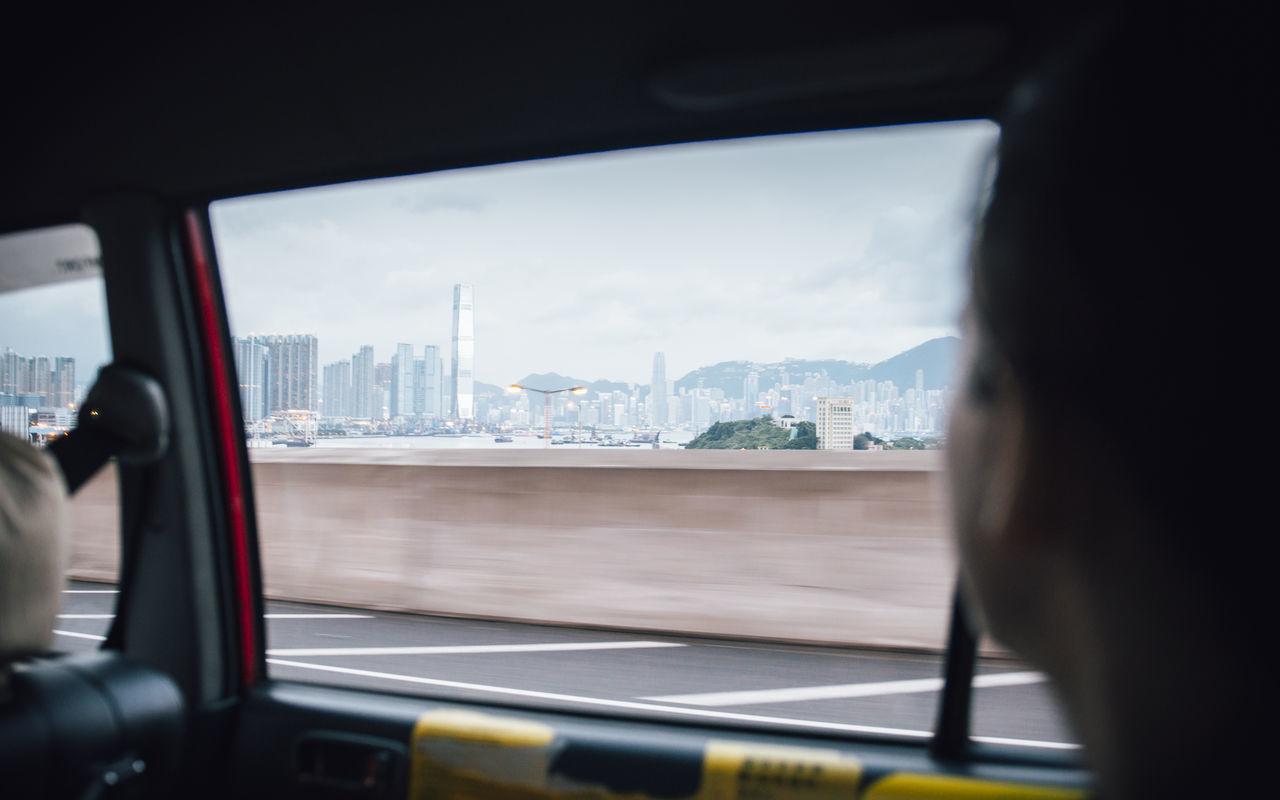 Close-Up Of Cityscape Seen Through Car Window