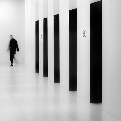 Man Walking In Corridor