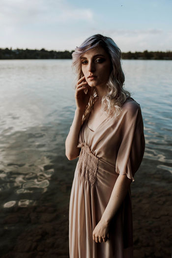 Beautiful Woman Beauty Fashion Hairstyle Lake Leisure Activity Lifestyles Looking At Camera Nature One Person Outdoors Portrait Real People Sky Standing Water Women Young Adult Young Women