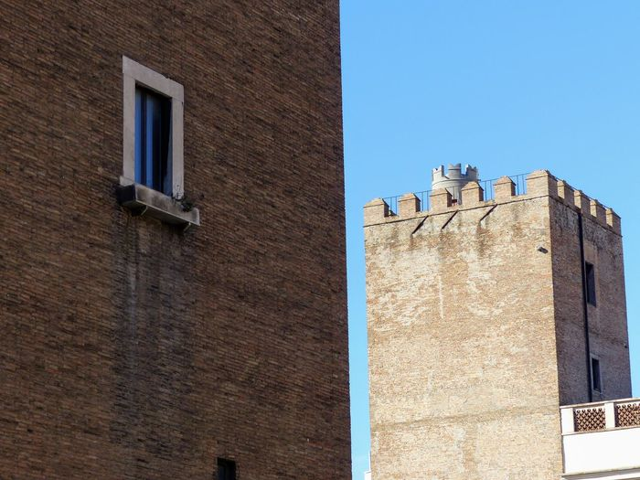 Medieval urban towers to Rome in Italy Medieval Detail Two Towers Travel Destinations Rome Italy❤️ Blue Sky Clear Sky Sunny Day 🌞 Battlements Extremity Antique Ancient Window Roof Architecture Building Exterior Sky Built Structure Historic