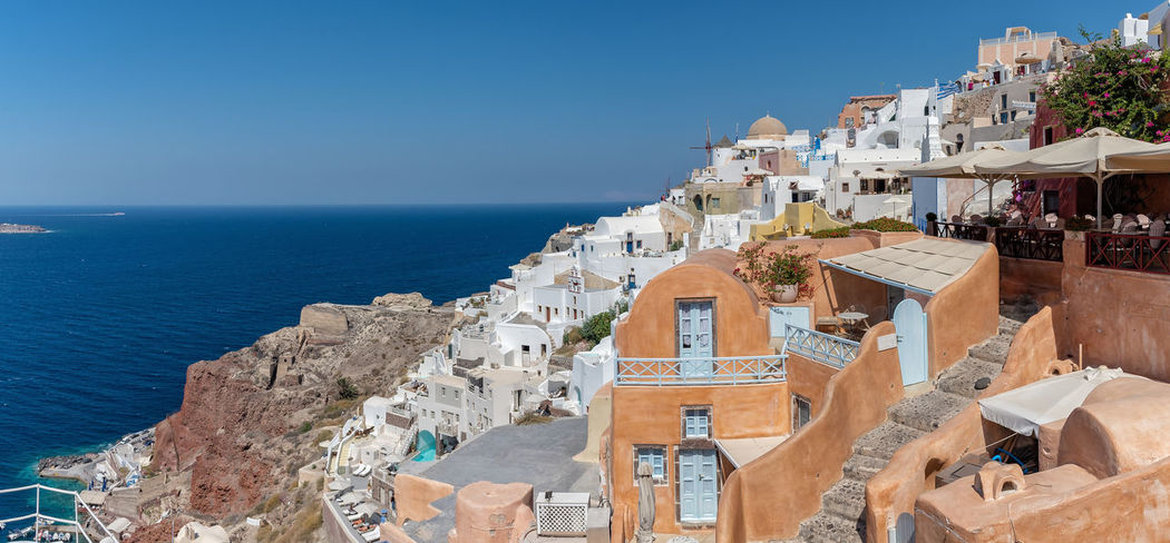 View of Oia - Santorini Cyclades Island - Aegean sea - Greece Greece Santorini Cyclades Mediterranean  Oia Village Island Architecture Volcano Caldera Sea Water Building Exterior Built Structure Travel Destinations Building Nature Travel Tourism Blue City Horizon Over Water Sunlight Residential District Town