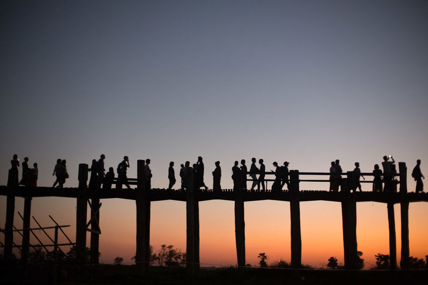 Crowds at the U Bein Bridge at sunset, Mandalay, Myanmar Architecture Clear Sky Copy Space Crowd Group Of People Large Group Of People Orange Color Outdoors Silhouette Sky Standing Sunset U Bein B U Bein Bridge