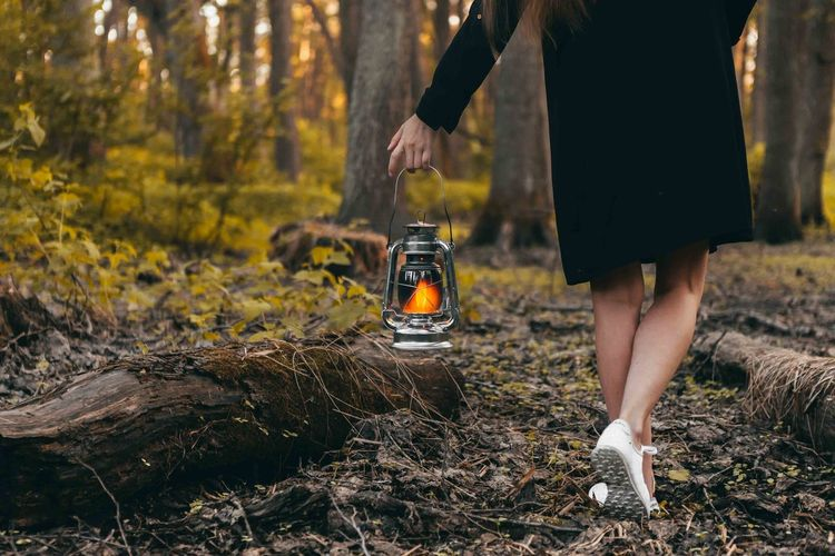 Beautiful legs of girl, walking in the forest with oil lamp. Summer time Adult Body Part Day Focus On Foreground Forest Human Body Part Human Foot Human Leg Human Limb Land Lifestyles Low Section Nature One Person Outdoors Plant Real People Shoe Tree Walking Women