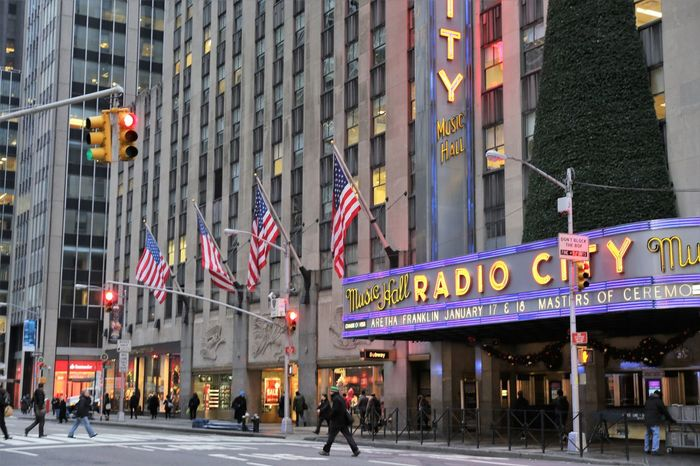 Radio City Music Hall, NYC Manhattan NYC LIFE ♥ NYC Photography NYC Street NYC Street Photography Radio City Music Hall Architecture Building Exterior Built Structure City Communication Day Incidental People Men Nyc Architecture Nyc Streets Outdoors People Real People Text Walking Western Script