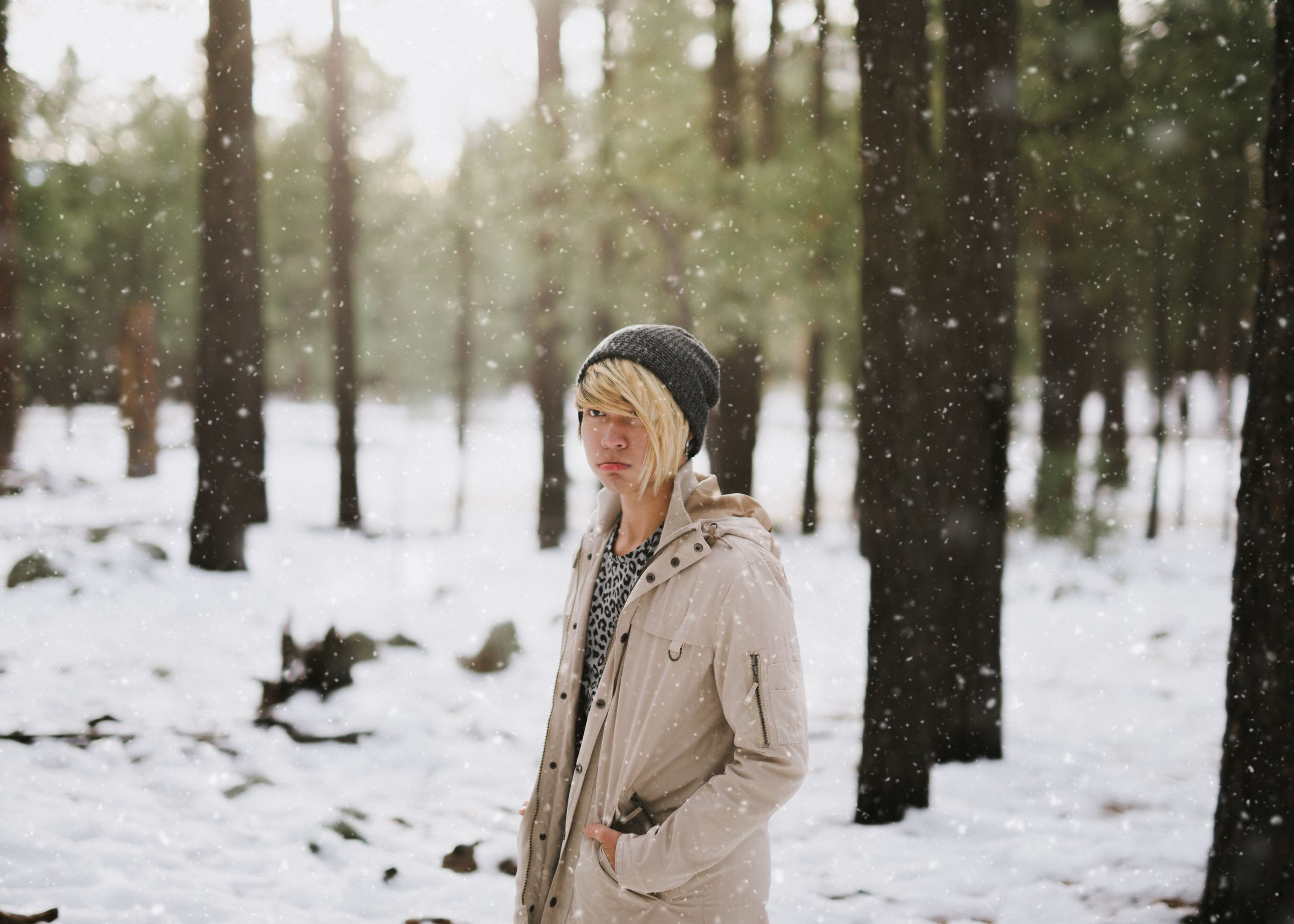 winter, cold temperature, snow, waist up, one woman only, snowing, adults only, only women, one person, warm clothing, outdoors, people, adult, snowflake, day, tree, smiling, human body part