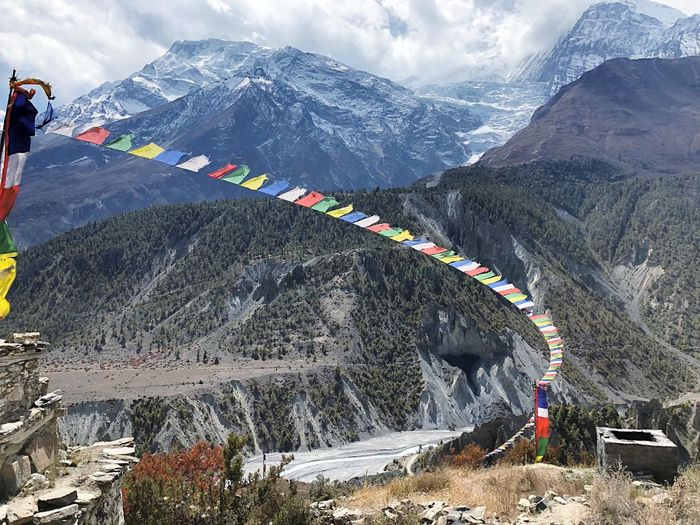 Prayer flags in front of Annapurna II Prayer Flags  Annapurna Nepal Nature Trekking Annapurna Circuit Mountain Snow Day Beauty In Nature Winter Mountain Range Cold Temperature Snowcapped Mountain Cloud - Sky Non-urban Scene Outdoors Sky Scenics - Nature