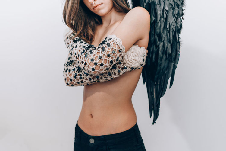 Winter activity for demons: knitting. Black Wings Knit Knitted  Wing Wings Demon Wings Conceptual One Woman Only Young Women Females Beauty Beautiful Woman Fashion Model Women Portrait White Background Lace - Textile Skin Torso Posing Body Part Semi-dress Lingerie