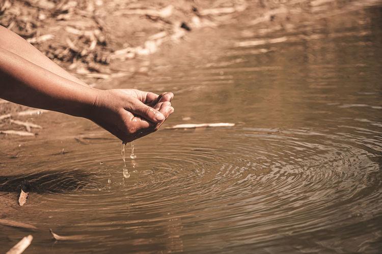 Midsection of man holding water splashing