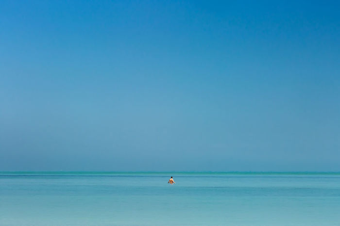A person enjoying the shallow waters of a Varadero Cuba beach. Beauty In Nature Blue Clear Sky Day Horizon Over Water Nature One Person Outdoors Scenics Sea Sky Tranquil Scene Tranquility Travel Destinations Vacations Water