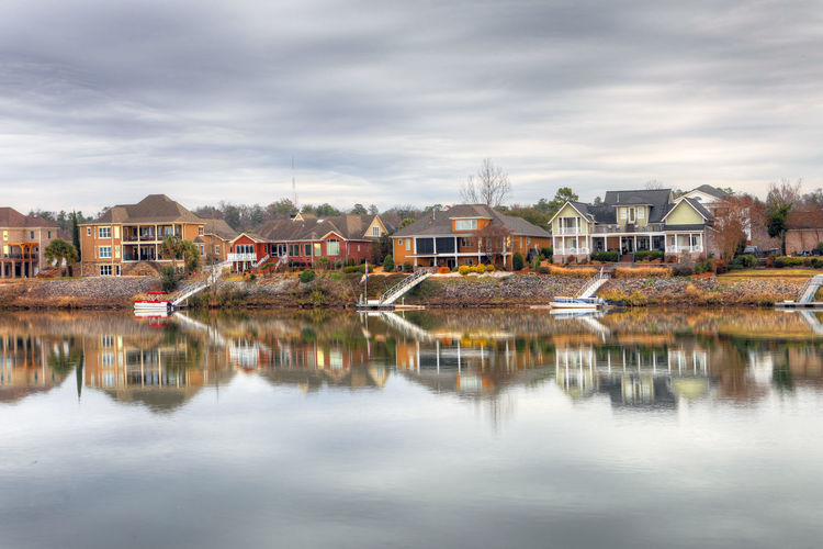 Reflection of houses and buildings in river