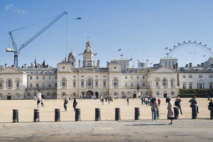 London, United Kingdom - October 11, 2018, Horse guards parade ground in London with in the background the London Eye Horse Guards Parade London Eye Tourism City London United Kingdom Architecture Building Exterior Group Of People Real People Travel History Outdoors Travel Destinations Built Structure