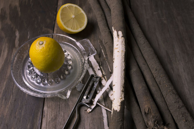 Cooking Schwarzwurzel Citrus Fruit Food Food And Drink Freshness Fruit Healthy Eating Healthy Lifestyle High Angle View Household Equipment Lemon Preparing Food Salsify SLICE Still Life Wood - Material Yellow