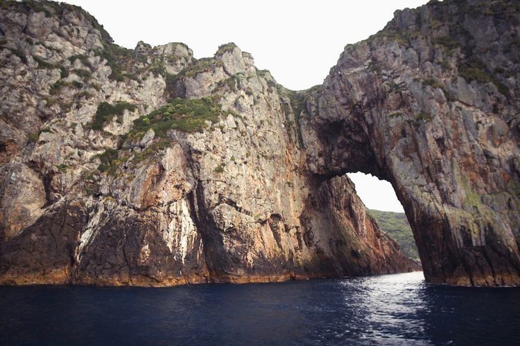 Poor knights islands Water Rock Rock - Object Solid Rock Formation Nature Beauty In Nature Sea No People Land Sky Scenics - Nature Cliff Tranquility Mountain Tranquil Scene Arch Geology Natural Arch Outdoors