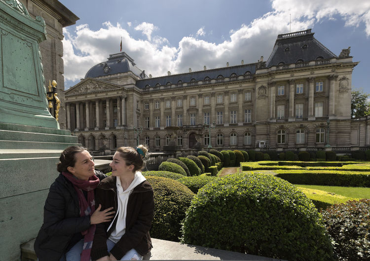 Mother and daughter next to the royal palace with its gardens in Brussels capital of Belgium. Architecture Belgium Vacations Adult Architecture Bruselas Building Building Exterior Built Structure Couple - Relationship Day Looking Men Nature Outdoors People Plant Real People Royal Palace Brussels Standing Togetherness Two People Women Young Adult Young Men