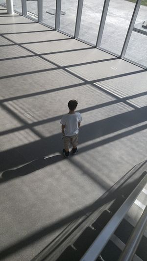 Waiting Metal Alone Patterns Everywhere Low Angle View City Life Boy Waiting Lost Boy Architecture People In Places The City Light Museum