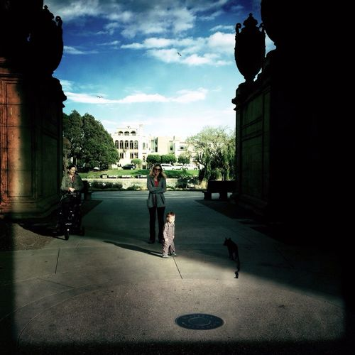 A little boy and dog meet in the The Palace Of Fine Arts, SF Impossible Moments