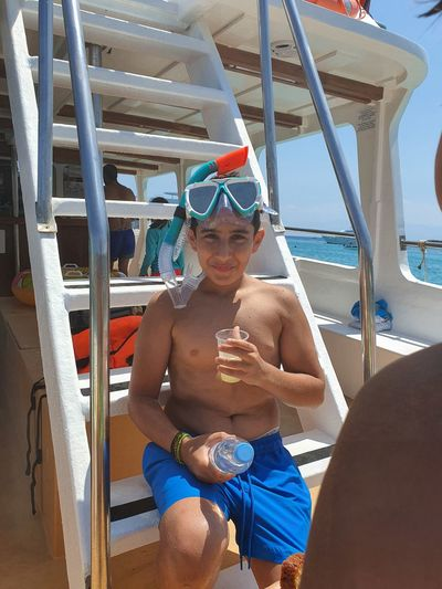 Drinking lemonade on the stairs of a cruise boat at akamas peninsula national park