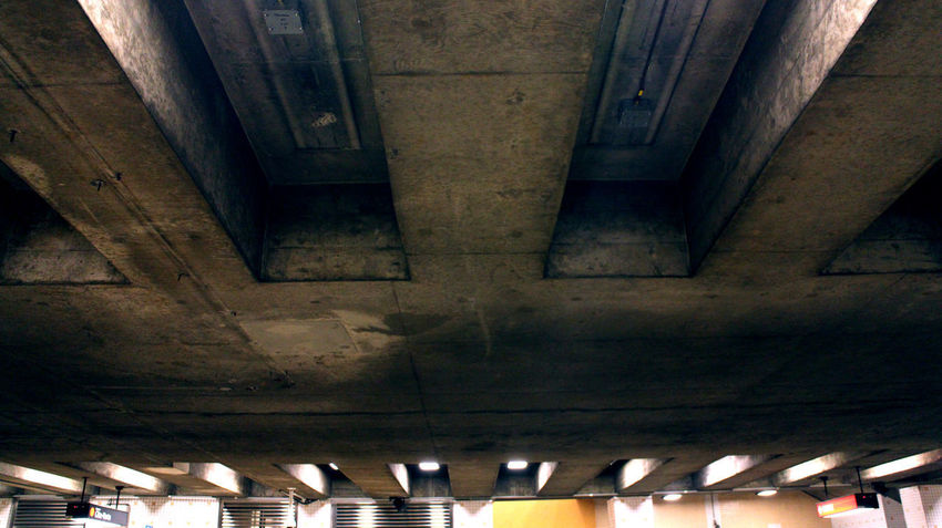 Photos taken in and around Montreal, winter of 2018. Montréal Montreal, Canada Passageway Cold Temperature Winter Ceiling Brutalist Architecture Architecture Built Structure Indoors  No People Illuminated Transportation Low Angle View Architectural Column Lighting Equipment In A Row Old Pattern Connection Wall - Building Feature Subway Underneath