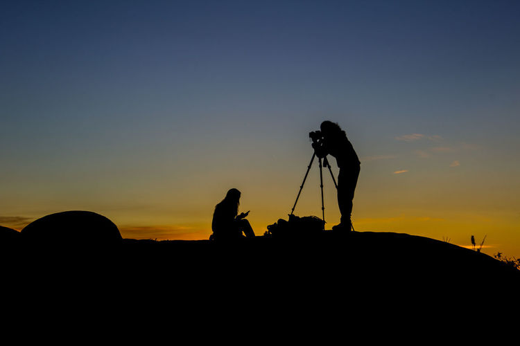 """Dawn at the summit of """"My Castle"""" hill. Silhouette Sky Tripod Photographing Real People Nature Photographer Orange Color Clear Sky Outdoors Sunrise Dawn"""