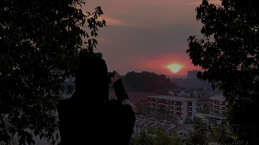 Sunset Sunsetlover Sunset View Sunset Sky Photographer In The Shot Photographer In Action Photogtapherlife Photographer Photographer Moments Architecture Architecturephotography Tree Outdoors Sky Day Second Acts