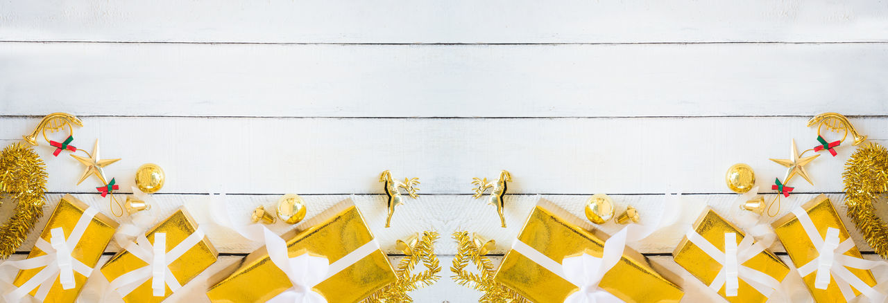 Low angle view of decoration hanging against wall
