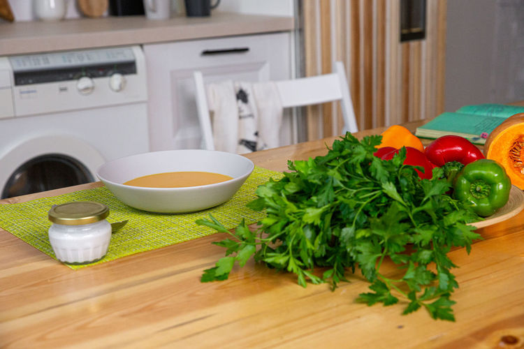 Fruits and vegetables on cutting board at home