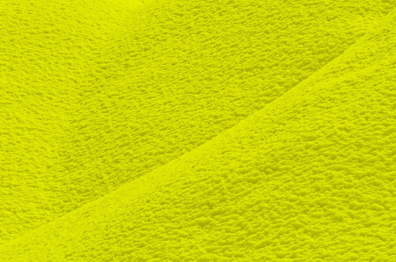 Full frame shot of yellow textured wall
