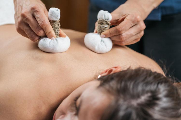 Bolus bag ayurveda massage with medicinal herbs and natural aromatic oils