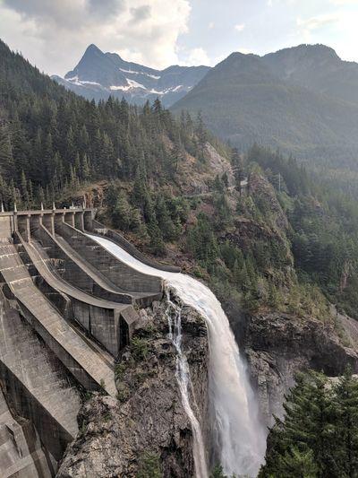 Dam on mountain against sky